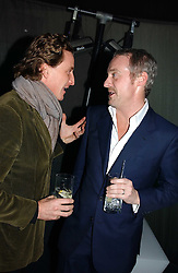 Left to right, TIM ATTIAS and ANTON BILTON  at a party hosted by Panerai and the Baglioni Hotel, 60 Hyde Park Gate, London on 6th December 2004.<br />