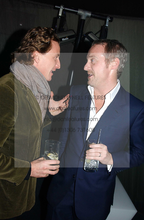 Left to right, TIM ATTIAS and ANTON BILTON  at a party hosted by Panerai and the Baglioni Hotel, 60 Hyde Park Gate, London on 6th December 2004.<br /><br />NON EXCLUSIVE - WORLD RIGHTS