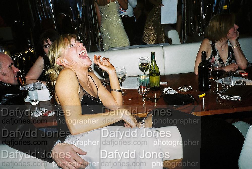 Michelle Collins and Ruby Wax. Gilda's Club party. Isola. London. 5/2/01 © Copyright Photograph by Dafydd Jones 66 Stockwell Park Rd. London SW9 0DA Tel 020 7733 0108 www.dafjones.com