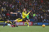 Burton Albion midfielder Marcus Harness (16) under pressure from Oxford United's Jamie Hanson (6) during the EFL Sky Bet League 1 match between Burton Albion and Oxford United at the Pirelli Stadium, Burton upon Trent, England on 2 February 2019.