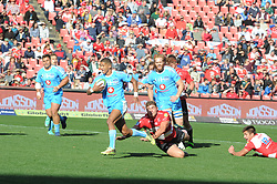14-07-18 Johannesburg. Emirates Airlines Park. Emirates Lions vs Vodacom Blue Bulls.<br /> 1st half. Manie Libbok evades Malcolm Marx and leaves Harold Vortser lying on his way to scoring the 1st try of the match.<br /> Picture: Karen Sandison/African News Agency (ANA)