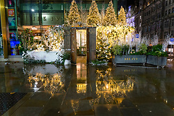 Edinburgh, Scotland, UK. 19 December 2020.  Views of streets and shops in Edinburgh City Centre on evening that Scottish Government announced the highest level 4 lockdown will be enforced from Boxing Day in Scotland.  Pic;  Exterior of The Ivy restaurant in the rain at night with Christmas decorations. Iain Masterton/Alamy Live News