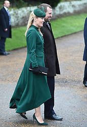 Autumn and Peter Phillips arriving to attend the Christmas Day morning church service at St Mary Magdalene Church in Sandringham, Norfolk.