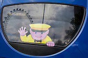 A detail of the recognisable face of the sightseeing company Megasightseeing, and the London Eye atraction on the rear of a parked bus on the Southbank, on 2nd May 2019, in London, England. Megasightseeing is part of the Megabus, a long distance coach operator operated by the Stagecoach Group. It commenced operating in August 2003, initially in the United Kingdom, and later expanding into continental Europe.