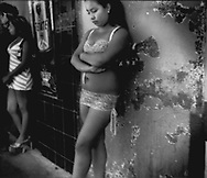 """Paradita, """"Standing Girl"""" waits for male customers on street in Coahuila District of Zona Norte, Tijuana.  Paraditas, or """"Standing Girls"""" are sex workers who may legally ply their trade in Zona Norte, less than 500 m from the Mexican / US border."""