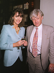 MR & MRS FRANK JOHNSON she was Lady Virginia Fraser mother of Lord Lovat and model Honor Fraser,  at a party in London on 17th June 1999.MTK 71