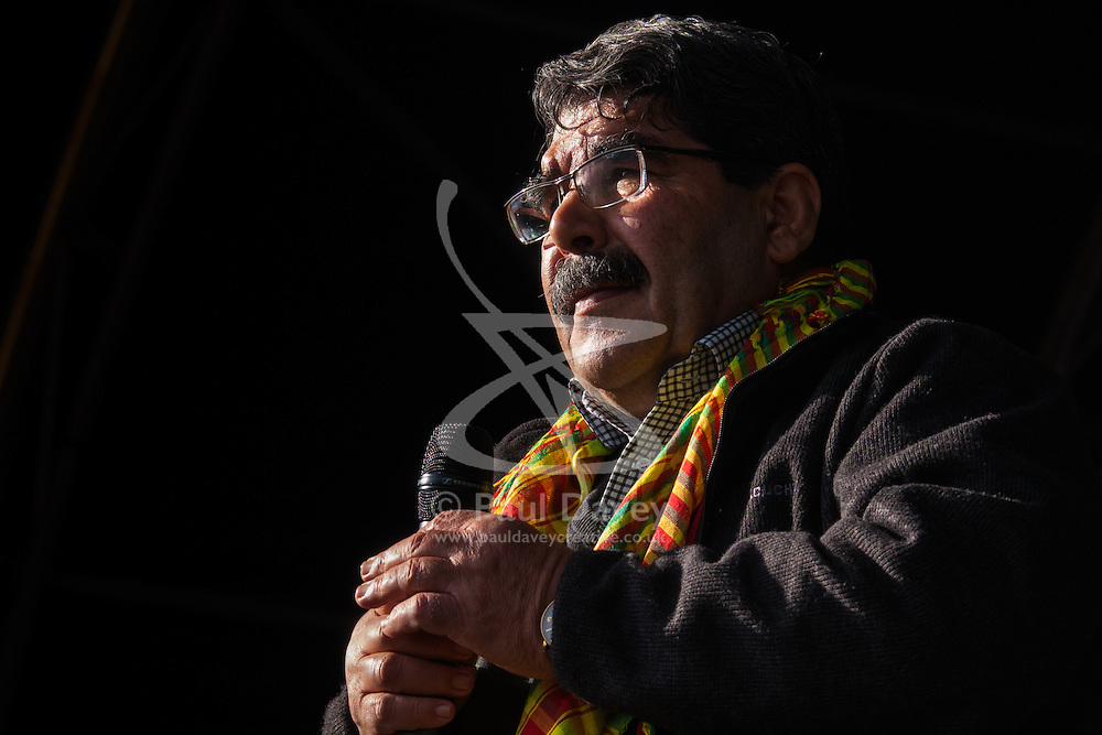 sbury Park, London, March 22 2015. Thousands of London's Kurdish community gather for Newroz, their traditional New year's celebrations. The exiled community mourns the death of Londoner and ex Royal Marine Erik Konstandinos Scurfield, a hero to them, who was killed fighting ISIS, and whose mother Vasiliki Scurfield addressed the crowd. ICTURED: Saleh Muslim delivers an emotional speech.