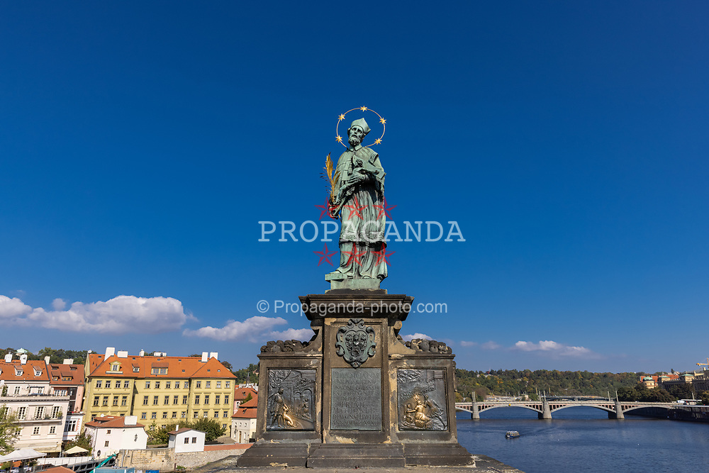 PRAGUE, CZECH REPUBLIC - Friday, October 8, 2021: The statue of John of Nepomuk, sculpted by Jan Brokoff in 1683 based on a model by Matthias Rauchmiller, on Charles Bridge in Prague. (Pic by David Rawcliffe/Propaganda)