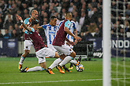 Jose Fonte of West Ham United makes a big tackle on Tom Ince of Huddersfield Town to stop him scoring.  Premier league match, West Ham Utd v Huddersfield Town at the London Stadium, Queen Elizabeth Olympic Park in London on Monday 11th September 2017.<br /> pic by Kieran Clarke, Andrew Orchard sports photography.