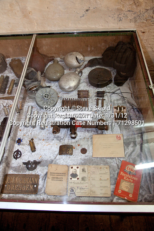 Display case of soldier's military gear and identification cards found at Hitler's Bunker. Konewka Central Poland
