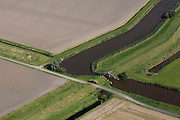 Nederland, Groningen, Oldambt, 08-09-2009; Coupure and sluis in de dijk van de Reiderwolderpolder, boven in beeld de Carel Coenraadpolder, ontstaan door landaanwinning in de Dollard.Cut and lock in the dike of the Reiderwolderpolder, top of the photo the Carel Coenraad polder, created by land reclamation in the Dollard.luchtfoto (toeslag); aerial photo (additional fee required); .foto/photo Siebe Swart