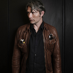 "Danish actor Mads Mikkelsen annoucing the upcoming shooting of ""The Nazi Officer's Wife"" by Barthelemy Grossmann"" at the 63rd Cannes Film Festival. France. 16 May 2010. Photo: Antoine Doyen"