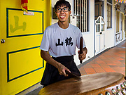09 JULY 2017 - SINGAPORE: A drummer practices for a lion dance troupe in the Chinatown section of Singapore.    PHOTO BY JACK KURTZ