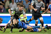 Mitchell Drummond of the BNZ Crusaders breaks the tackle to head for the try line during the Canterbury Crusaders v the Western Force Super Rugby Match. Nib Stadium, Perth, Western Australia, 8th April 2016. Copyright Image: Daniel Carson / www.photosport.nz