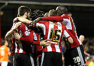 Jon Toral goal celebration during the Sky Bet Championship match between Brentford and Blackpool at Griffin Park, London, England on 24 February 2015. Photo by Matthew Redman.