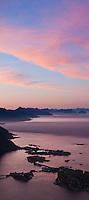 Sunset view from summit of Reinebringen peak over Reine and Lofoten islands, Norway