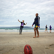 Will Genia playing rugby with locals during the Australian teams recovery session at  Takapuna Beach at the IRB Rugby World Cup tournament, Auckland, New Zealand, 17th October 2011. Photo Tim Clayton...