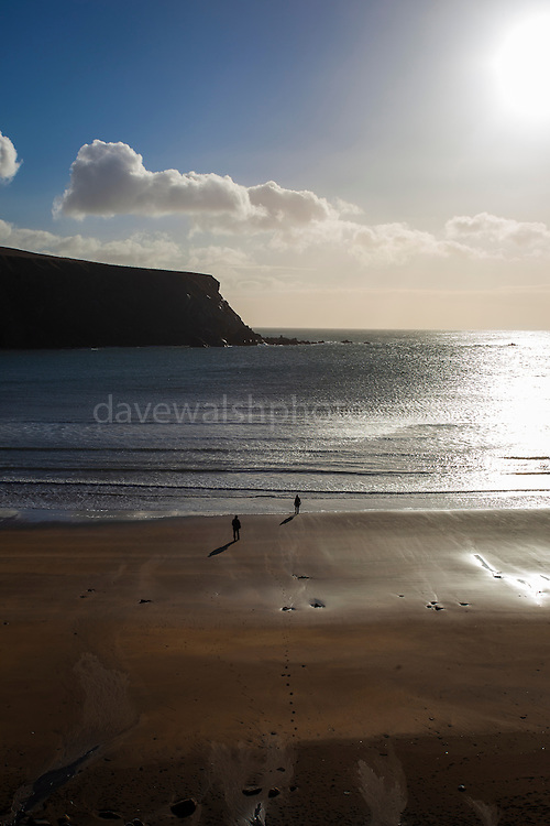 """Two people on Silver Strand, Or Trabane Beach, near Malin Beg, Donegal, on Ireland's Wild Atlantic Way. This mage can be licensed via Millennium Images. Contact me for more details, or email mail@milim.com For prints, contact me, or click """"add to cart"""" to some standard print options."""