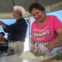 Husband and wife team Anna Lucero and Johnny Lucero prepare a green chili stew for the chili cooking contest during the Milan Fall Festival Saturday. Johnny also entered the pumpkin pie contest while his wite made a salsa and a red chili.