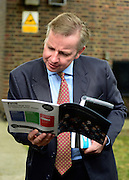 © Licensed to London News Pictures. 01/09/2012. Hammersmith, UK Michael Gove, Secretary of State for Education looks at a school prospectus after he speaks at The Free Schools Conference at The West London Free school in Hammersmith today, 1st September 2012.  The event is aimed exclusively at 102 proposer groups that have received approval to open free schools. Photo credit : Stephen Simpson/LNP