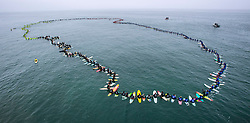 June 20, 2017 - Huntington Beach, California, USA - A total of  511 surfers float on their boards and hold hands in the ocean to create the world's largest paddle out ''Circle of Honor'' in Huntington Beach Tuesday morning, June  20, 2017. (Photo by Mark Rightmire, Orange County Register/SCNG) (Credit Image: © Mark Rightmire, Mark Rightmire/The Orange County Register via ZUMA Wire)