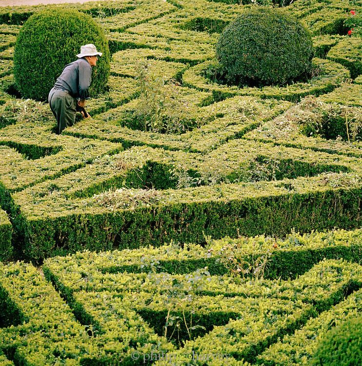 A gardener tends the gardens of the Palácio dos Marqueses de Fronteira, Fronteira Palace, in Lisbon, Portugal