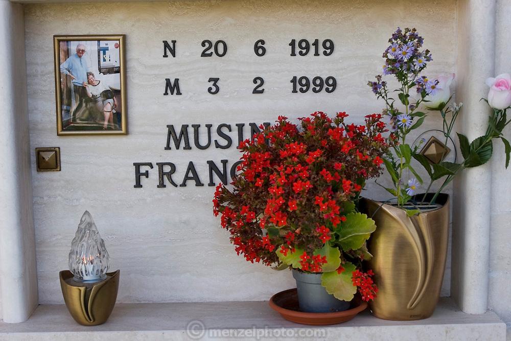 Cemetery in Radicofani, Italy (near Pienza) with photos on a gravestone.