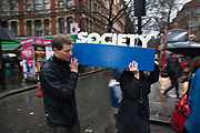London, UK. Saturday 13th April 2013. A coffin with the word 'society' in flowers is paraded along Charing Cross Road to the Margaret Thatcher Death Party in Trafalgar Square, to celebrate the late Prime Minister's passing away.