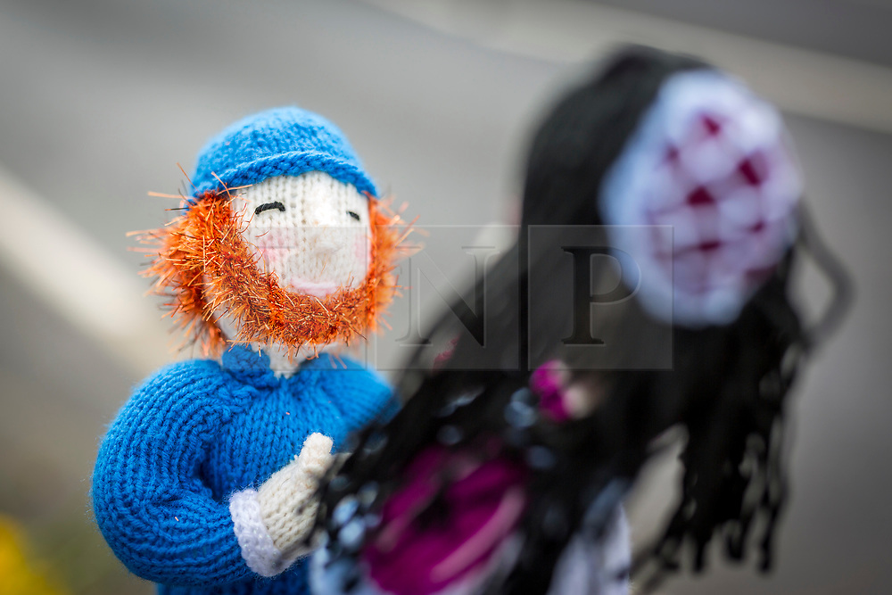 © Licensed to London News Pictures. 13/05/2018. Thirsk UK. Emma Feely's woollen depiction of Prince Harry on one knee with Megan Markle. The Thirsk Yarn bombers have decorated the town centre of Thirsk in North Yorkshire this morning with Prince Harry & Megan Markle wedding related woollen creations to celebrate the upcoming royal wedding at the weekend. Photo credit: Andrew McCaren/LNP