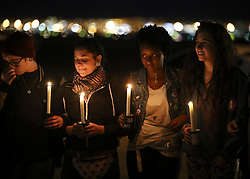 Oct. 3, 2017 - Las Vegas, Nevada, USA - People attend a candlelight vigil to mourn the victims of a mass shooting in Las Vegas, the United States. At least 59 people were killed and 527 others wounded after a gunman opened fire Sunday on a concert in Las Vegas in the U.S. state of Nevada, the deadliest mass shooting in modern U.S. history.  (Credit Image: © Wang Ying/Xinhua via ZUMA Wire)
