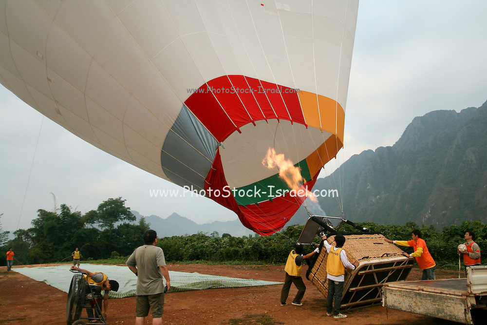 Ground Crew prepare to launch a hot air balloon Photographed in Laos