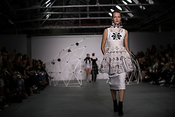 HOLLY FULTON PRESENTATION AT LONDON FASHION WEEK AW16 - Holly Fulton is a womenswear and accessories designer living and working in East London. <br /> <br /> Born in Scotland, Holly studied in Edinburgh before going on to the prestigious Masters at the Royal College of Art. She established her eponymous label in 2009 after gaining industry experience in London and Paris.<br /> <br /> Holly won Elle New Designer 2010, Scottish Young Designer 2009 and 2010, Elle Talent Launch Pad 2010 and Emerging Talent Accessories at British fashion awards 2010. She was a part of London's Fashion East platform for two seasons before being awarded sponsorship and support from the UK's NEWGEN initiative five seasons in a row.<br /> <br /> The Holly Fulton label epitomises modern relaxed luxury. Attention to detail, complex graphic embellishment and witty twists are what make Holly's work instantly recognisable. Hand rendered, digitally manipulated print coupled with unusual fabrications and embellishment create strong unified looks, from top to toe.<br /> <br /> Since her debut collection in February 2009 Holly has developed her own unique visual language, drawing upon a dizzying array of sources, from art deco lines and Bauhaus shapes, to pop art painting and psychedelic illustration. Rich multi-layered surfaces reflect a genuine love of both art history and popular culture. The research of a collection is of paramount importance to Holly, whose references have ranged from Joan Collins to Lady Chatterley, Margate to Mexico. Jewellery completes what Holly calls her 'total look', often cleverly worked into the clothing itself.