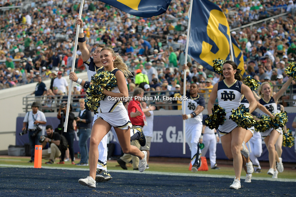 Notre Dame cheerleaders run through the end zone after a touchdown during the first half of an NCAA college football game against Navy in Jacksonville, Fla., Saturday, Nov. 5, 2016. (Photo by Phelan M. Ebenhack)