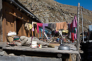 A man sleeping on his terrace outisde his house wearing traditional Kinnauri clothing on 20th October 2009, Himachal Pradesh, India. The region of Spiti and Kinnaur is a remote and tribal area of the Indian Himalayas near the Tibetan border.