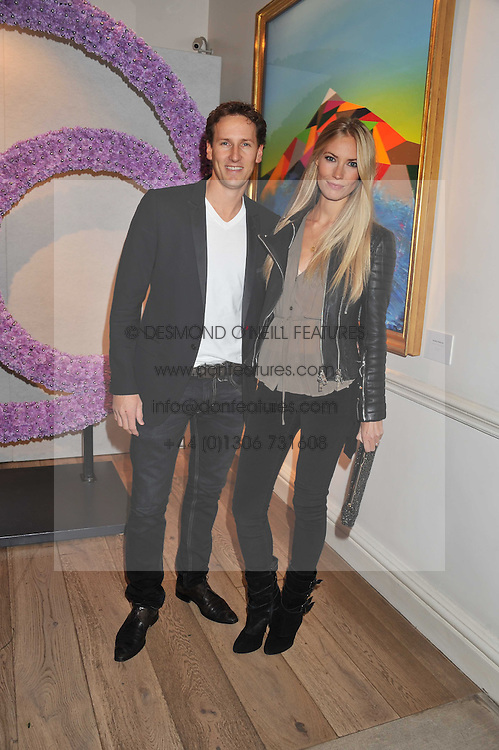BRENDAN & ZOE COLE at a reception to celebrate the publication of Candy and Candy: The Art of Design held at the Halcyon Gallery, 24 Bruton Street, London W1 on 26th October 2011.