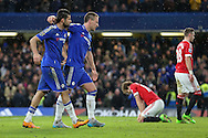 Chelsea's John Terry celebrates Chelsea's Diego Costa's goal during the Barclays Premier League match between Chelsea and Manchester United at Stamford Bridge, London, England on 7 February 2016. Photo by Ellie Hoad.