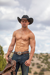 shirtless muscular cowboy with a saddle