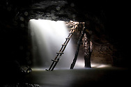 Waterfall in a cave at the Grand Canyon, with a ladder to climb out.  Province of Napo, Archidona, Ecuador.