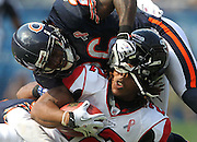 Chicago Bears defensive back Tim Jennings (26) grabs a little facemask while bringing down Atlanta Falcons running back Jacquizz Rodgers (22) in the fourth quarter at Soldier Field on Sunday, Sept. 11, 2011.