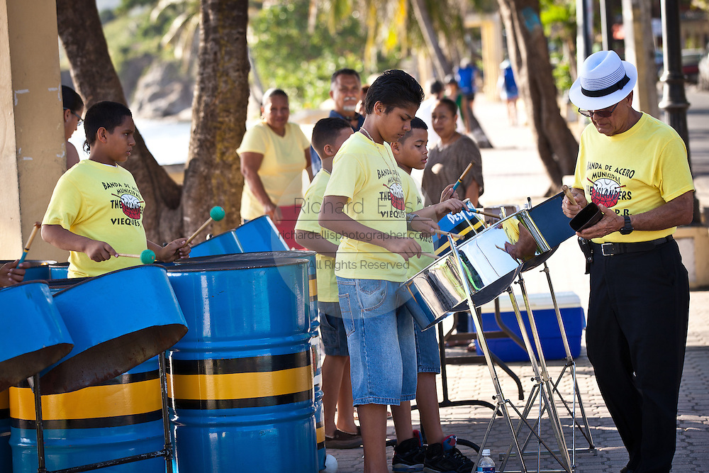 School children from the Vieques Island steel drum band perform along the waterfront in Vieques Island, Puerto Rico.