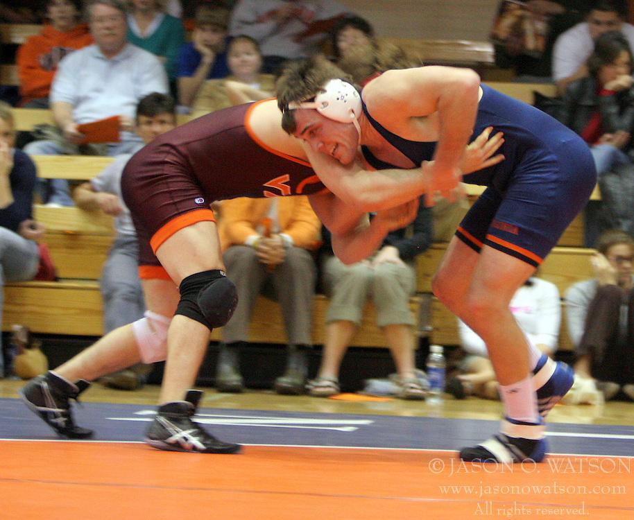 Kyle Narkiewicz takes on Virginia Tech's Mark Czarny.  Narkiewicz won the match by major decision, 14-6 and UVA beat the Hokies 25-15 at Mem Gym.