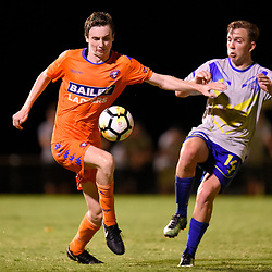 BRISBANE, AUSTRALIA - JANUARY 27: Mitch Hore of Lions and Ryan Palmer of Strikers compete for the ball during the Kappa Silver Boot Grand Final match between Lions FC and Brisbane Strikers on January 27, 2018 in Brisbane, Australia. (Photo by Patrick Kearney)
