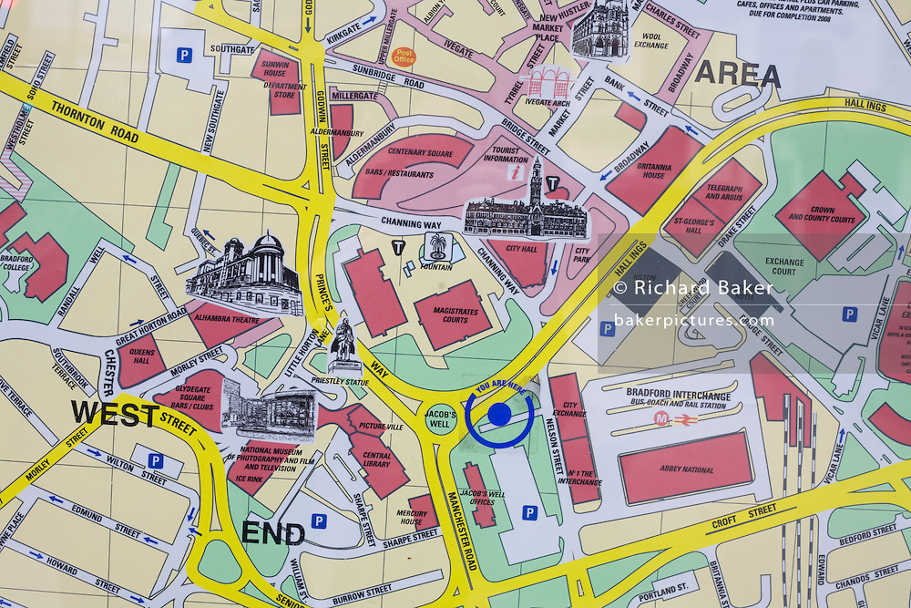 An arrow pointing to the You Are Here location on a map of Bradford city centre, showing the streets, roads and landmarks of this Yorkshire town.