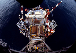 Stock photo looking down onto a jack up in the ocean
