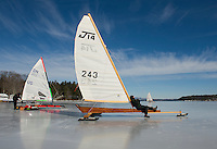 Phil Dolsen waits for the wind as he sits and takes in the sunshine on the J14 he built in 2008.  He joined members of the New England Yacht Association for a day of ice sailing on Lake Winnipesaukee from Ames Farm Inn beach on Monday.  (Karen Bobotas/for the Laconia Daily Sun)