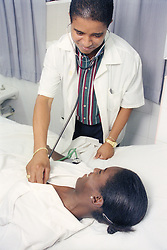 Doctor examining patient in Cuban health clinic,