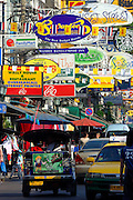 Brightly coloured signs on Khao San Road, Bangkok Thailand Asia