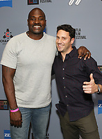 """Marcellus Wiley (L) and guest at DTLA Film Festival """"INSIDE GAME"""" Los Angeles Premiere held at Regal LA Live on October 24, 2019 in Los Angeles, California, United States (Photo by © Michael Tran/VipEventPhotography.com"""