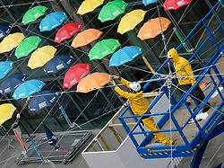 © Licensed to London News Pictures. 10/06/2019. London, UK. An installation of umbrellas being installed in the pouring rain, at Heathrow Airport in London. Photo credit: J Almasi/LNP