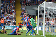 Damien Delaney of Crystal Palace (bottom c on the ground) scores an own goal to make it 1-2. he deflected an Alexis Sanchez of Arsenal (l) header into his own net. Barclays Premier league match, Crystal Palace v Arsenal at  Selhurst Park in London on Sunday 16th August 2015.<br /> pic by John Patrick Fletcher, Andrew Orchard sports photography.